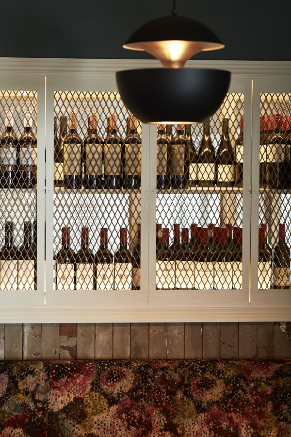 Bar seating tables timber panels pendant lighting, wine cabinate, luxury fabric on seating