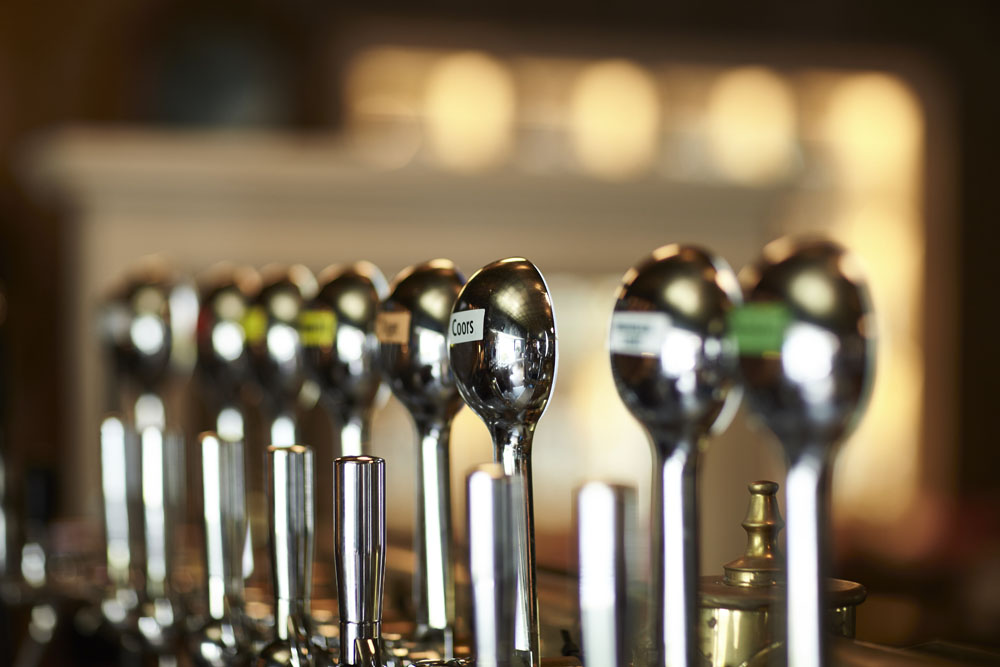Bar taps display, shiny metal bar taps
