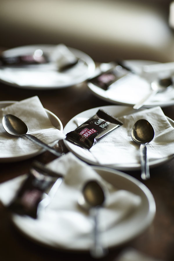 Coffee napkins spoons, saucers, coffee biscuits