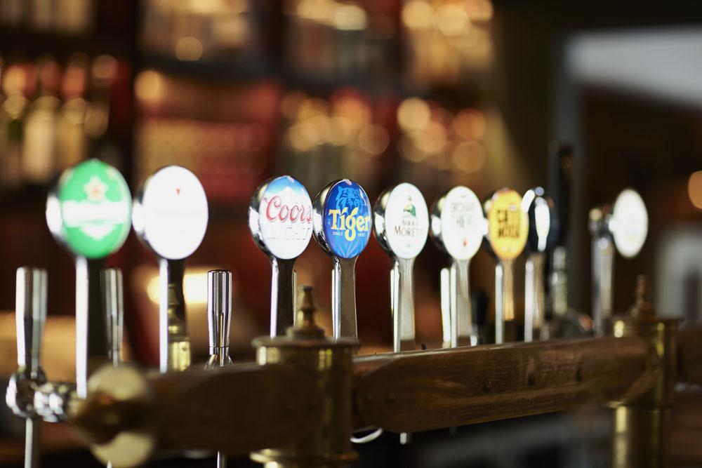 Bar taps, beautiful display, wooden bar stool, lights