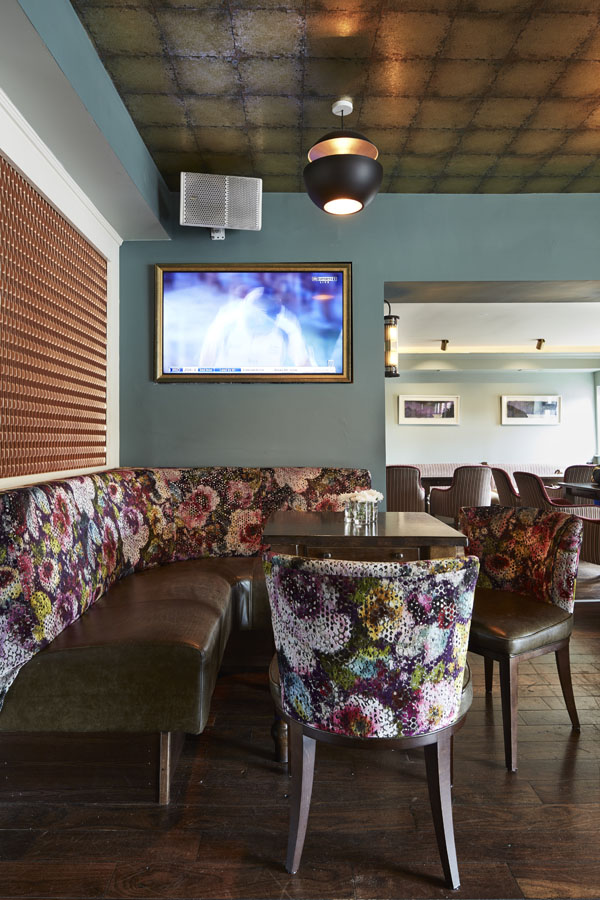 Bar area, comfortable seating tables timber panels pendant lighting, flat screen TV