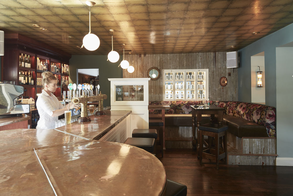 Bar, comfortable cozy seating tables timber panels pendant lighting, copper counter-top, music, ambience