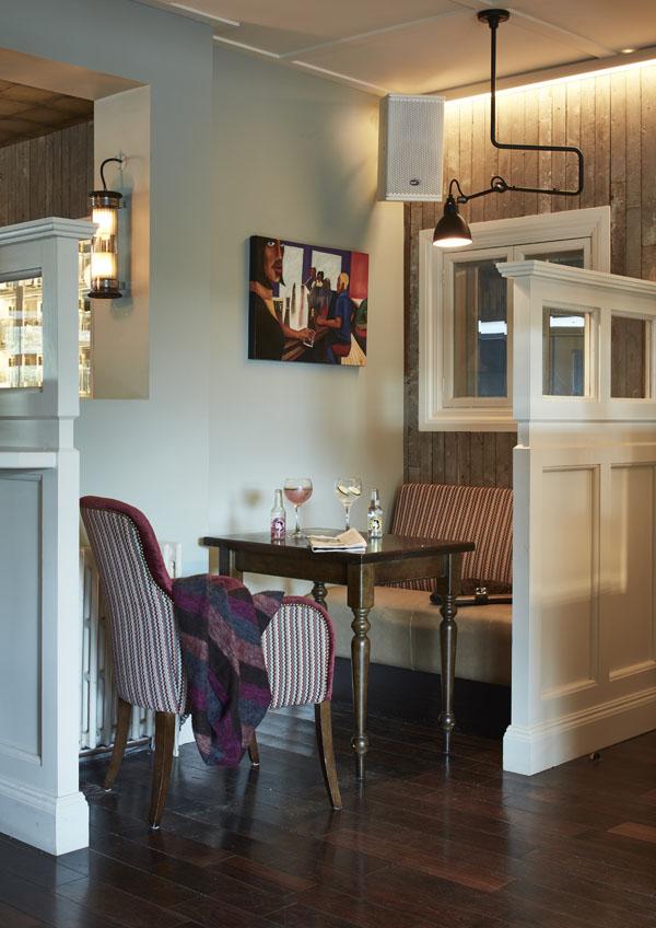 Bar seating tables timber panels pendant lighting, timber flooring