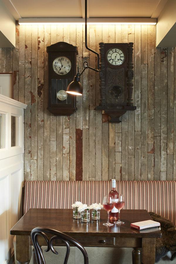 Bar, comfortable seating tables timber panels pendant lighting, wall clocks