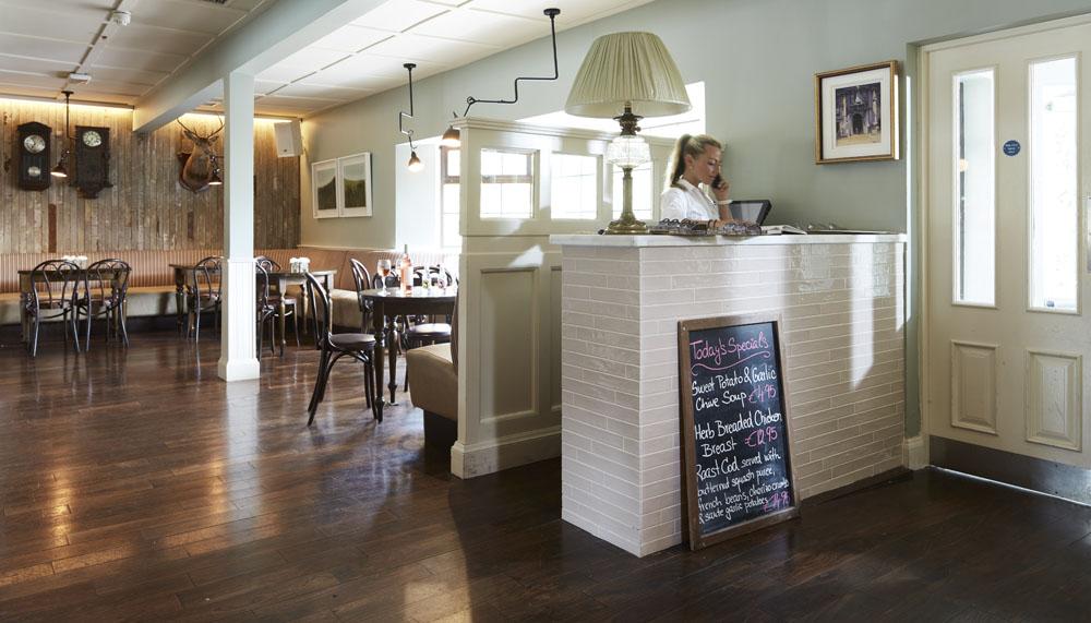 Bar seating tables timber panels pendant lighting