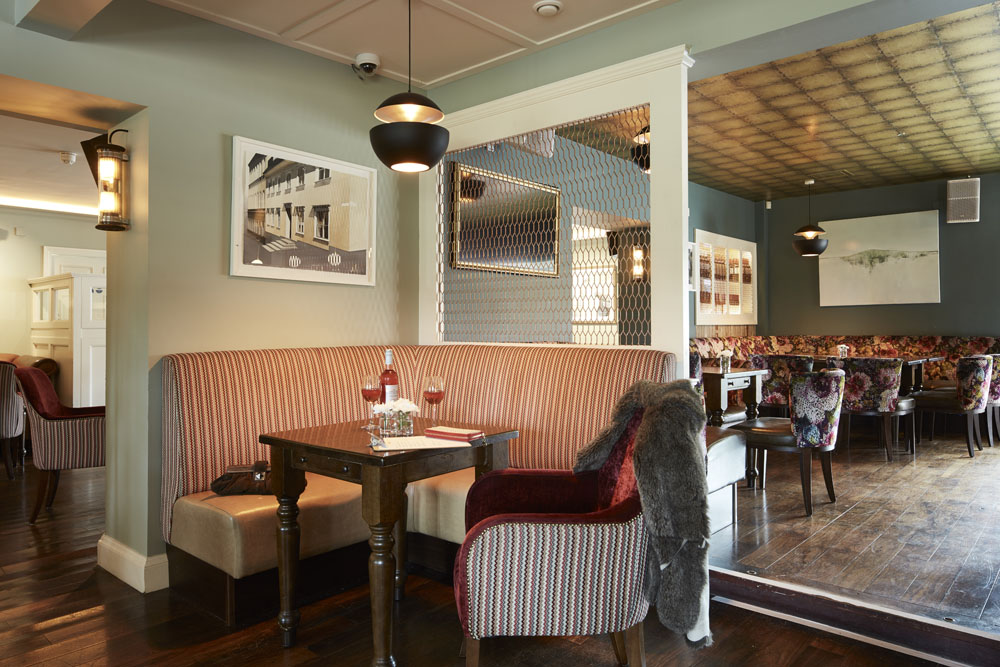 Bar/restaurant seating tables timber panels, flooring, pendant lighting, waitress, ambience