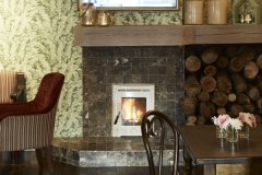 Bar area, comfortable seating, flat screen tv, log fire, cozy area, green foliage wallpaper, beautiful ambience