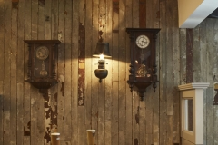 Bar area drinks seating pendant lights timber paneling on wall with 2 beautiful wall clocks