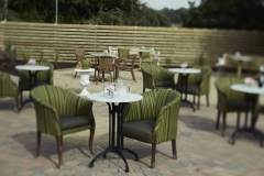 Garden terrace comfortable seating/tables, folage, flowers