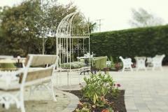 Exterior garden area patio seating flowers
