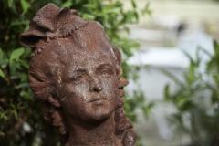 Garden Statue set amongst folage